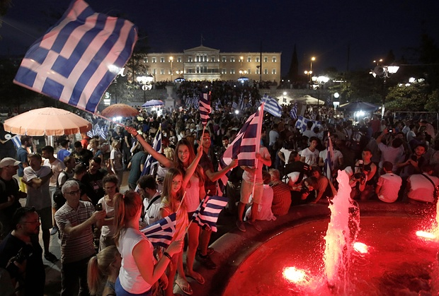 Greeks wave their nation's flag to celebrate 'NO' vote on austerity.