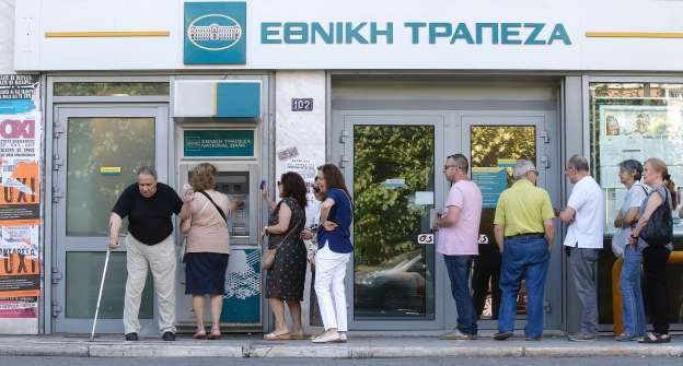 "Large lines could still be seen outside ATMs all over the country, as worried citizens continue to withdraw their daily limit of €60 ($67), a restriction imposed by the banks. (Pictured) Referendum campaign posters that read ""No"" in Greek are seen as people line up at an ATM. CHRISTIAN HARTMANN/Newscom/Reuters"