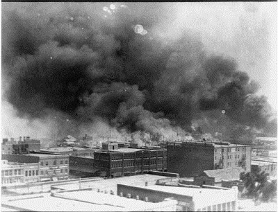 This is not Detroit in 1967; it is the Black Wall Street in the Greenwood neighborhood of Tulsa, Oklahoma in 1921, consumed by flames set by KKK members and other whites. Three hundred Black residents died, thousands of homes and business were forever destroyed.