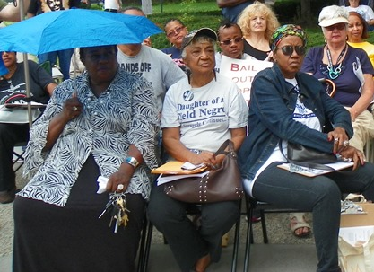 Long-time Detroit education activist Helen Moore (center), attended the New Orleans conference and reported back from it at a People's Assembly in Detroit August 29, 2015. She is flanked by (l) former City Councilwoman JoAnn Watson and (r) Cecily McClellan, VP of the Detroit Active and Retired Employees Association (DAREA).