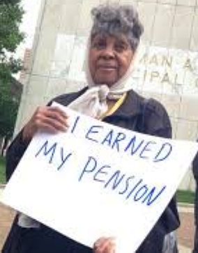 Detroit retiree protests at Coleman A. Young Municipal Center.