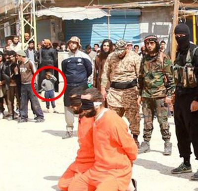 ISIS executes Syrian soldiers in front of terrified civilian population including children.
