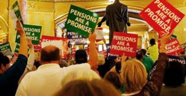 Illinois pension cuts protest at State Capitol in Springfield, Ill.