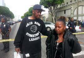"""Eyewitnesses call fatal Los Angeles police shooting of homeless ... www.finalcall.com-350 × 243-Search by image From left, Skid Row activist """"D.J."""" General Jeff consoles Skid Row resident Ina Murphy ollowing LAPD shooting of homeless, mentally ill Black man/Photo Final Call"""