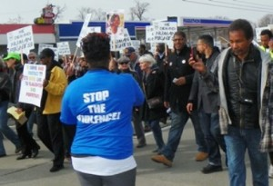 Marchers for justice for Floyd Dent in Inkster carry sign for Aiyana April 3, 2015.