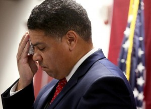 Dane County DA Ismael Ozanne wipes sweat from his face as he announces decision not to charge white cop in Tony Robinson, Jr. death March 6.