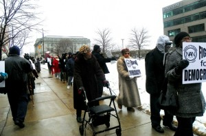 Detroiters march outside Jones Day Cleveland office March 35, 2013.