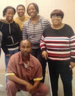 Philadelphia juvenile lifer Tyrone Jones, with family, was re-sentenced to parolable term after city's DA banned all JLWOP sentences.