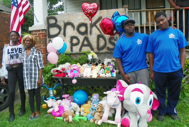 (L to r) The children's great-grandmother Marie Jackson, grandmother Nicole Jackson, and uncles Delvontie and Justin Thompson at memorial set up in front of Jackson home on Nottingham.