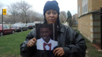Janet Cooksey with photo of her son, Quintonio LeGrier, 19.