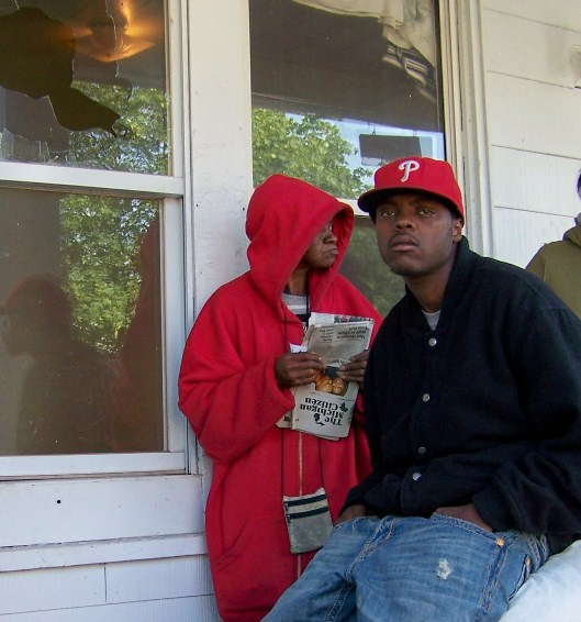 oAnn Robinson and grandson Mark Robinson on porch morning of Aiyana killing May 16 2010. Ms. Robinson passed away within the year. Photo by Diane Bukowski