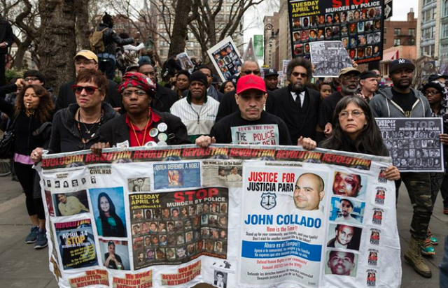 Joshua Lopez center during march for his uncle John Collado in New York City.
