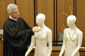 Cuyahoga County Judge John P. O'Donnell examines mannikins representing Timothy Russell and Malissa Williams during trial.