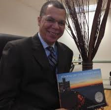 "Judge Terrance Keith with his book, ""Sunrise on the Detroit River."""
