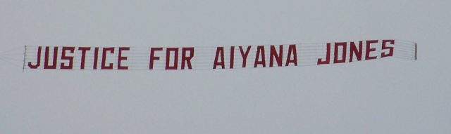 Justice for Aiyana Jones banner flies over her east-side Detroit neighborhood May 16, 2011.