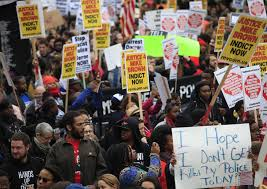 Protesters demand indictment of Darren Wilson.
