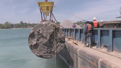 Pipe for Karegnondi Water Authority is hoisted into Lake Huron.