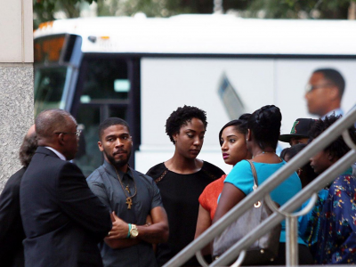 Family members of Keith Lamont Scott gather outside the Mecklenberg courthouse. Photo: The Independent.