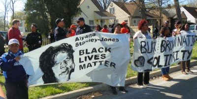 Protesters marched with a banner remembering Aiyana on April 28, 2015, after police killed Terrance Kellom, 19, in his father's home.