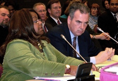 Wayne County Prosecutor Kym Worthy testifies at state legislature with AP Richard Moran at her side.