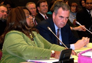 Wayne County Prosecutor Kym Worthy with Asst. Pros. Robert Moran at her left, testifying at state legislative hearing.