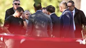 Officials confer at site of Burbank killing.