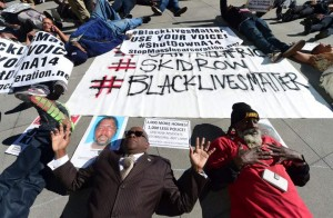 """Protesters conduct """"die-in"""" on LA street."""
