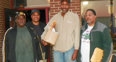 Cornell Squires (rear) interviewed and reported on massive lay-offs taking place in the Detroit Water and Sewerage Dept. He is shown here with (l to r) laid-off workers Sammy Barber, Edward Collins, and Dean E. Fox Sr. after interview at Bert's.
