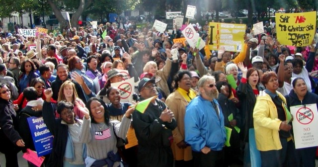 Detroit Public Schools teachers walked out across the district in 2001 to rally in Lansing against bill that would have opened the way to more charter schools. They succeeded for the time being, only to face the devastation to come.