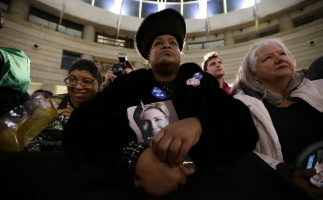 Lennette Williams, with daughter Mailauni at her right, listen as Democratic presidential nominee Hillary Clinton speaks. Photo: Portland Press Herald
