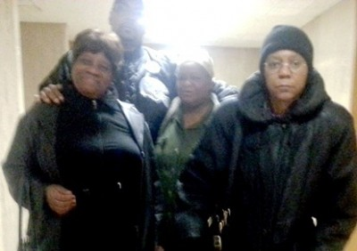 Lennette Williams (center), with attorney Vanessa Fluker at right, supporters Arnetta Grable (l) and Min. Malik Shabazz (top) after court hearing Nov. 19, 2014