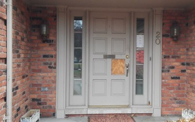 Door to the Williams home in Grosse Pointe Farms, which police have not repaired after breaking in to seize Mailauni June 13, 2014.