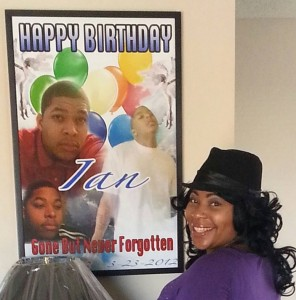 Lidjinet Barber with poster remembering her son Ian May, 18, killed by a retired Detroit cop with a past,