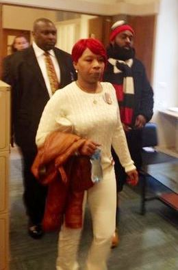 Mike Brown parents Lesley McSpadden and Michael Brown, Sr. on their way into meeting.