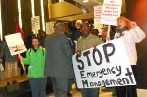 "Marchers demand ""Orr out the door"" at hotel where he was living in Detroit, May 1, 2014."