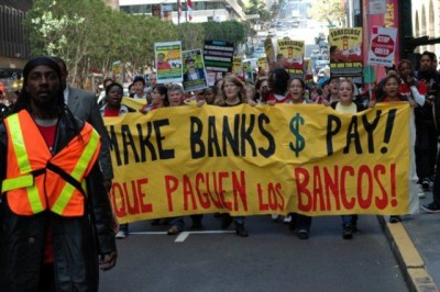 Occupy Oakland marches in California against the banks.