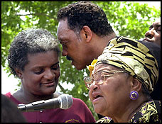 Raynard Johnsons mother Maria Johnson, Rev. Jesse Jackson, and Mable Till Mobley, mother of Emmett Till, lynched in 1955.
