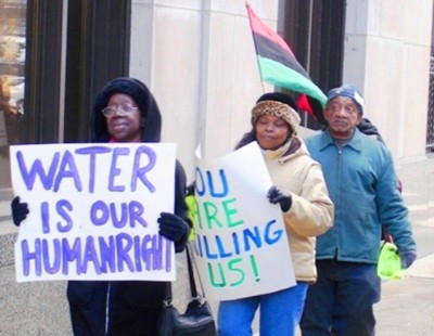 The late renowned activist Mary Shumake and others march outside Detroit Water Board Building.