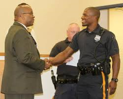 Bridgeton Mayor Albert Kelly welcomes Braheme Days as newest full-time officer of police dept.
