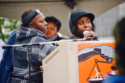 Kimberly Griffin (r)speaks about her son's death at the Detroit March for Justice as Mertilla Jones (l) and Monica Lewis-Patrick (center) listen. Photo: Detroit People's Platform