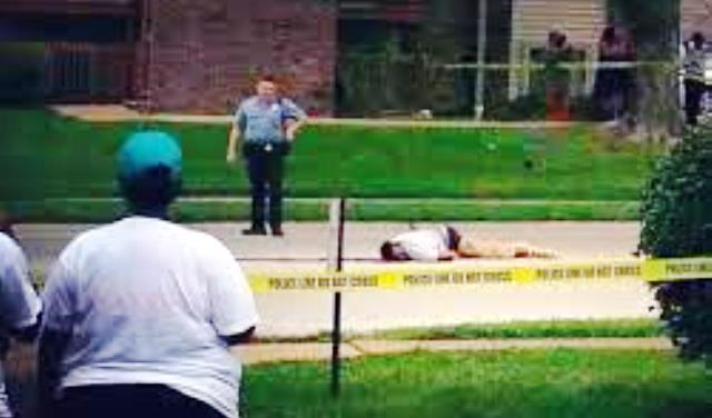 Mike Brown lay in street for over four hours after Wilson executed him, with his blood running out until it turned black.