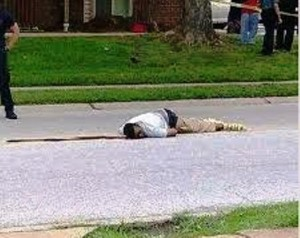 Michael Brown, 18, lies dead in street Aug. 9, 2014, killed by cop Darren Wilson.
