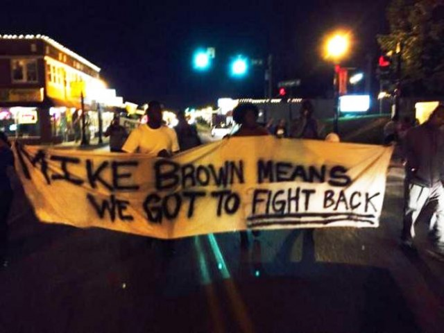 Protesters march outside Ferguson police station Sept. 25, 2014.