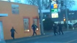 In this still frame taken from a cell phone video provided by Dario Infante and taken on Feb. 10, 2015, Antonio Zambrano-Montes, left, turns to face police officers while running from them in Pasco, Wash. Moments later, Zambrano-Montes was shot and killed. Pasco police said he threw multiple rocks, hitting two officers, and refused to put down other stones. (AP Photo/Dario Infante)   AP