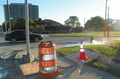 This hydrant, connected by tubing to an unknown underground line, has been spraying large amounts of water for two weeks. Other hydrants along E. Jefferson have been observed doing the same.