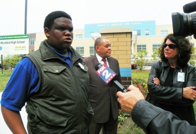Student at Mumford High School, then part of the EAA, tells media about terrible conditions there May 28, 2013 as Board President Herman Davis and member Elena Herrada listen.