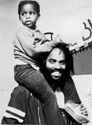 Political prisoner Mumia Abu Jamal with son in earlier years.