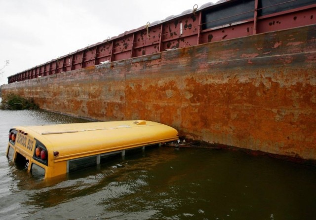 New Orleans public school bus submerged during Katrina, a portent of how the state would use the flood to destroy public education in the city.
