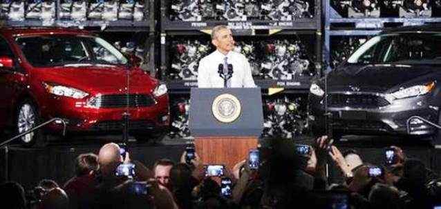 "U.S. Pres. Barack Obama celebrates auto industry ""rescue"" at temporarily closed Ford plant in Wayne, MI. Jan 7, 2015."