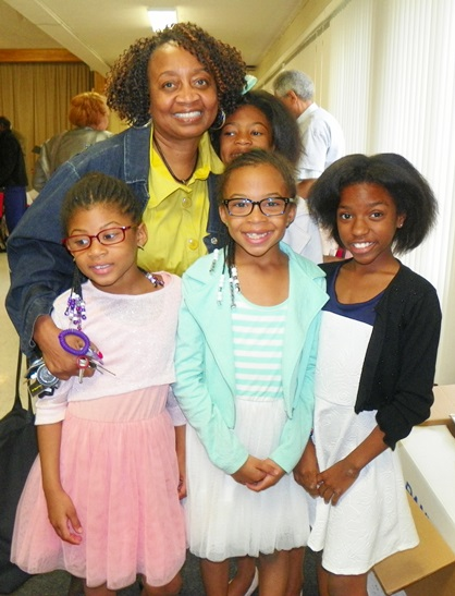 At prayer breakfast, children to whom Detroit water is life: (l to r) Christa Dailey, 7, Alyse Dailey, 8, Amiah Sanders, 11; in rear, Ramona Hall and Tayla Dailey, 10.